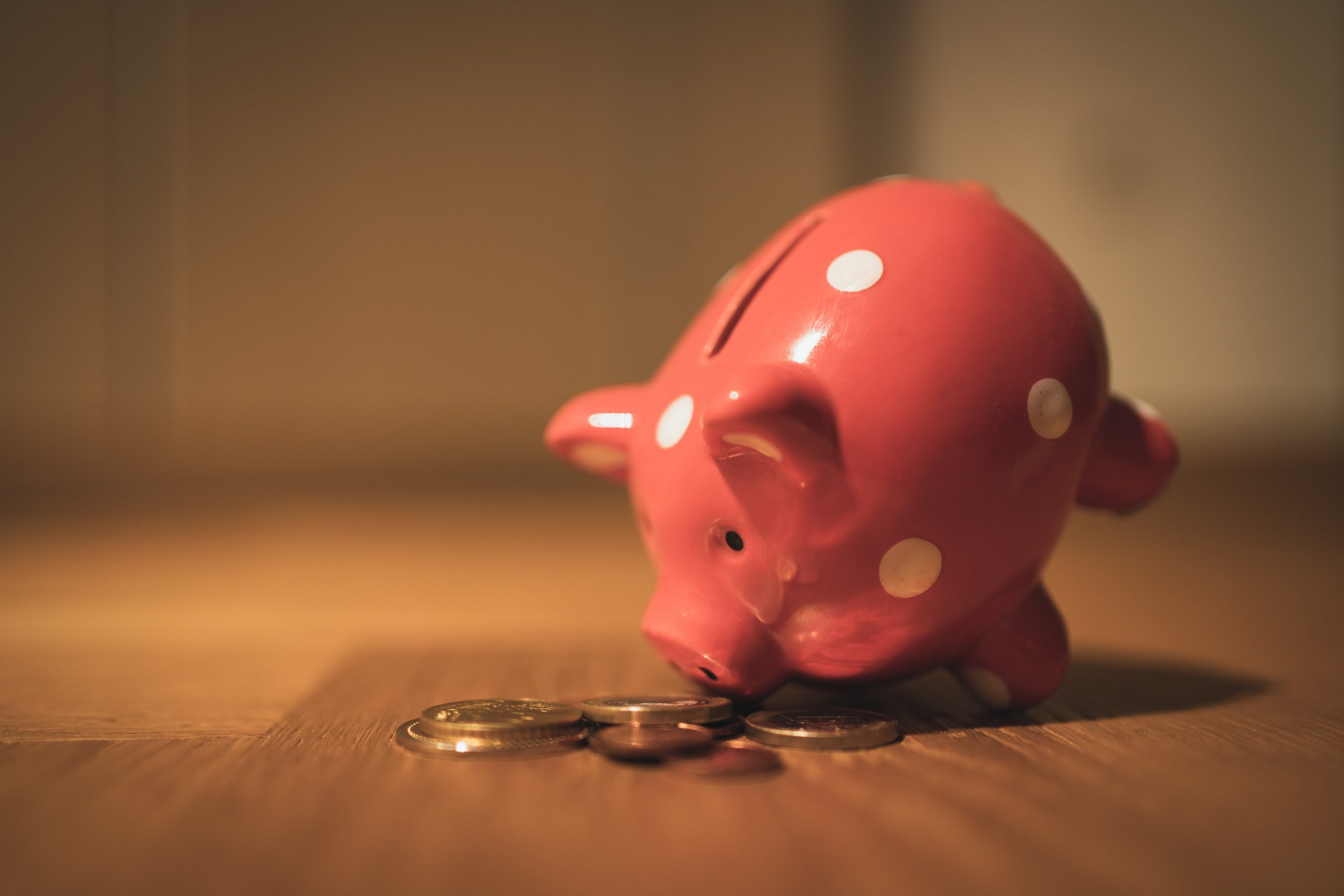 Coins and a piggy bank to represent cost savings from using salary advances